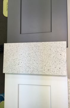 Echelon white and slate shaker cabinets & Ceasarstone Quartz Reflections #7141