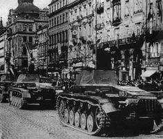 Dishonoring the pledges he made at Munich, Hitler ordered the Whermacht to invade Czechoslovakia (March 15, 1939). Here German Mark II tanks move into Wencelas Square in Prague.