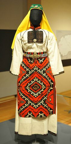 Macedonia Costume Macedonian woman's wedding dress with a visually stunning apron. Source: Zhegligovo. From the Museum of International Folk Art in Santa Fe, New Mexico