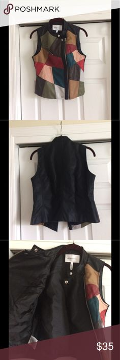 Patched Faux-Leather Moto Vest Add some color to your life! Colorful patchwork front and solid black back. Fully lined. Stand-up collar. Pair it up with your favorite pair of skinny jeans. BCBGeneration Jackets & Coats Vests