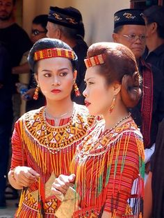 Women in ceremonial dress in a funeral procession from Cultural Travel in Tana Toraja, Sulawesi, Indonesia
