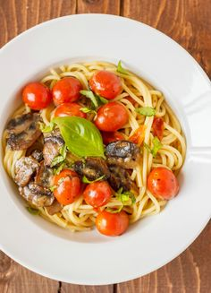 Caramelized Mushrooms, Roasted Garlic, and Cherry Tomatoes over Pasta