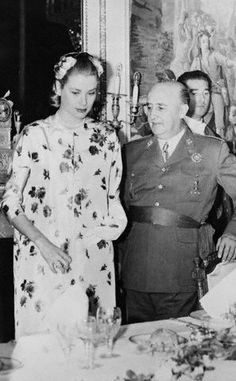 Generalissimo Fracisco Franco, Spain's Chief of State, seating Princess Grace at a luncheon in Madrid. May 15, 1956