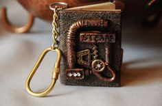 I have watched them make this by hand, this Steampunk Keychain by A&B Dragonarth, really wonderful craftsmanship, very detailed, for sale on Etsy, $15.95