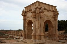 triumphal arch of severus in leptis magna, africa