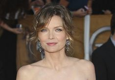 Michelle Pfeiffer better and better.  Great hair, soft makeup, fab earrings.