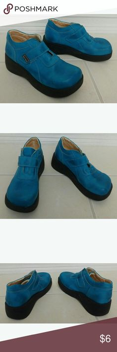Turquoise Blue Platform Boots Really cool 90's Retro Style platform boots  There is no size on them, I purchased them in Europe. Fits 7- 7.5 Shoes