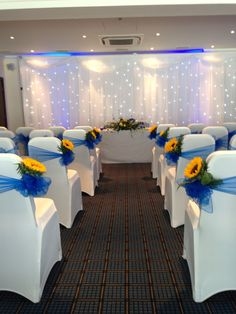 Royal blue sashes with sunflowers on white covers