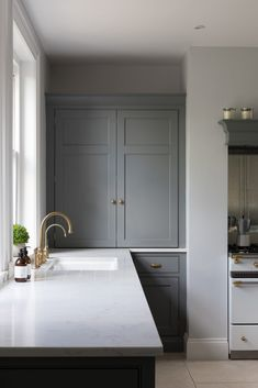 Aged brass Perrin & Rowe taps work perfectly with the cool blue/grey colour palette and light quartz worktops in this kitchen project. Open Plan Kitchen Living Room, Home Decor Kitchen, Home Kitchens, Kitchen Design, Kitchen Ideas, Grey Kitchens, Kitchen Interior, Humphrey Munson, Modern Country Kitchens