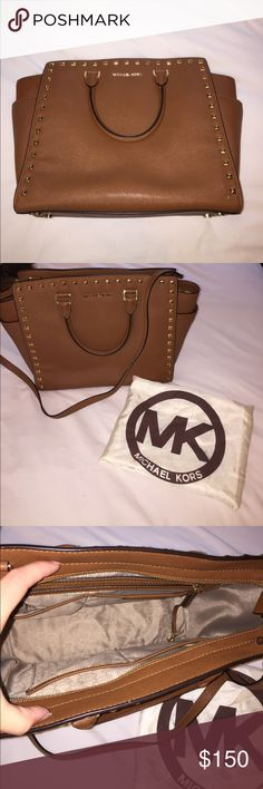 Michael Kors Tote Purse with Cross Body Strap No wear and tear besides one small white scuff on the front at the bottom. Inside lining in great condition. 2 different strap options! Michael Kors Bags Totes