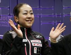 Mao Asada of Japan waves after performing during the ladies free skating at the ISU World Figure Skating Championships in London, Ontario, March 16, 2013.