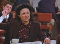 "Elaine listens to Kramer fill her in on what he read in the manuscript in, ""The Doodle."""