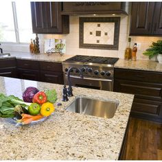 Bronze kitchen fixtures with light granite and dark cabinets = perfection!