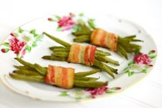 Bacon Wrapped Green Beans  I use canned whole green beans and season with salt, garlic powder, red & black pepper. After wrapping in bacon, I use a toothpick to hold it together. Halfway though cooking, I flip the bacon/green beans using the toothpick to ensure it's cooked thoroughly on both sides.