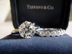 Perfect. My fav! Round cut diamond ring with a wonderful diamond setting as the band.