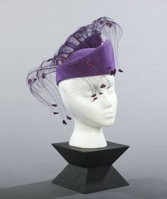 Jack McConnell, New York, Heliotrope Felt Cocktail Hat, trimmed with jeweled and dyed pheasant feathers.