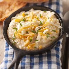 Creamy Cheese Grits - they're not just for breakfast anymore. Two cheeses amp up the flavor in this favorite breakfast side.