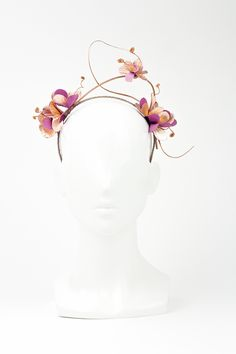 The Eternal Headonist - Champagne Cocktail - Pink/Gold Delicate Halo Style Leather Floral Headband by Felicity Northeast, $320.00 (https://www.theeternalheadonist.com/headpieces/champagne-cocktail-pink-gold-delicate-halo-style-leather-floral-headband-by-felicity-northeast/)
