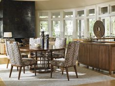 Island Fusion Meridien Round Dining Table with Animal Print Dining Chairs | Tommy Bahama Home Furniture