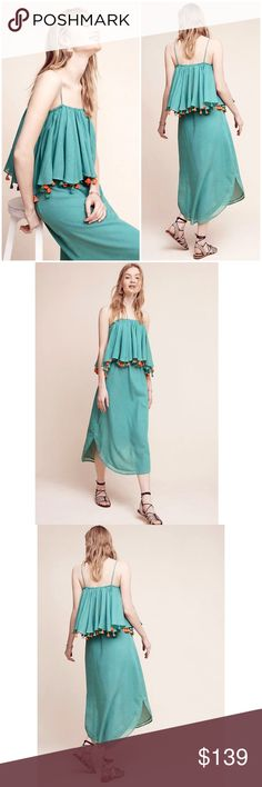 """NWT ANTHROPOLOGIE Carolina K Tiered Tassel Dress Brand new with tags NWT ANTHROPOLOGIE Carolina K Tiered Tassel Dress. A soft cotton dress that draws the eye with playful tassel detailing and a flattering shape. Size: Large Color: Green Cotton Adjustable straps Pullover styling Dry clean Imported Dimensions Regular falls 50"""" from shoulder Photo credit to Anthropologie Anthropologie Dresses Midi"""