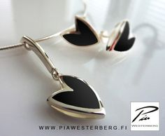 Silver necklace and earrings with black enamel. Own work. Webshop: www.piawesterbergwebshop.com