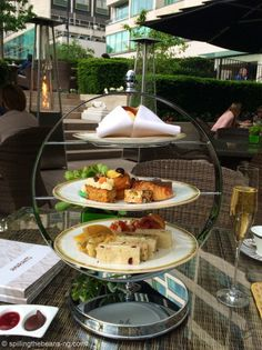 Indulging in the afternoon tea tradition in London is a must! This was at the garden terrace of the Four Seasons at Park Lane. London Blog, Four Seasons, Afternoon Tea, Terrace, Table Settings, Traditional, Park, Architecture, Garden