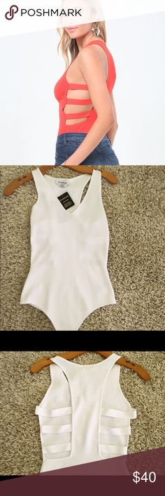 "Bebe side strap knit bodysuit Super cute bodysuit with strappy side detailing . Snap panty closure.Feel free to make me an offer😉. I do not trade . Measurements:  53% Rayon, 47% nylon Center back to crotch: 27.5"" (70 cm) bebe Tops"