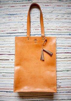 handmade leather bag - http://www.etsy.com/listing/82988497/leather-tote-bag-hand-stitched