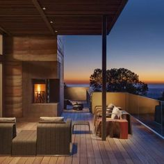 Is everything better with a sunset at twilight? This wooden exterior and outdoor area is pretty spectacular with a special backdrop.