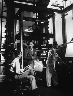 Walt Disney in multiplane camera room during making of Alice in Wonderland. THIS IS NOW AT THE FAMILY MUSEUM in SF.