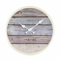 NeXtime The Home Plank clock creates a feeling of blue skies, seagulls and sand under the feet. Made out of real wood, with a Mediterranean sun-bleached look, this clock turns every home or office into an Ibiza beach club! Finish: Grey, Size: H x W x D Wall Clock Wooden, Wooden Case, Diy Wall Clocks, Wood Wall, Farmhouse Wall Clocks, Wall Clock Online, Wall Clock Design, Plank Walls, Diy Wall Decor
