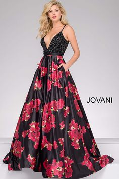 Gorgeous floor length prom ballgown features multi color floral print full satin skirt and beaded bodice with spaghetti straps and a plunging v neckline.