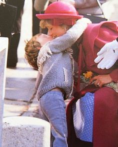 01 April 1982: Seven months pregnant with Prince William, Princess Diana is pictured recieving a spontaneous hug from a little boy from the crowd during a visit to Chinatown in Liverpool