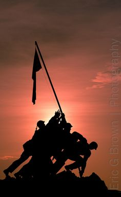 Of the six men raising this flag, three would die in combat before the battle for Iwo Jima was won.