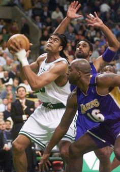Boston Celtics' Pervis Ellison, left, finds his way towards the hoop through the defense of Los Angeles Lakers' Rick Fox, back, and John Salley (16) in the first half in Boston on Monday, Dec. 20, 1999. (AP Photo/Elise Amendola) ORG XMIT: BXG102
