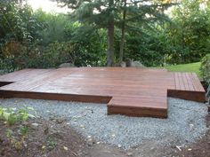 detached deck outdoor area... i'd put a little bit of fencing behind it for partial privacy