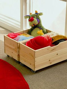 Wooden toy bins on wheels can easily slide under the bed or under end tables to store kid's toys anywhere in your apartment.
