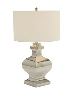 Captivating Steel Table Lamp.  Table Lamps Help In Enhancing The Overall Beauty Of Any Room Space. This Steel Table Lamp Is One Such Piece. It Is Crafted From Durable Material That Would Keep It In Good Condition For Years. In This Lamp, The Base Is Artistically Crafted Having Shining Finish. The Lamp Shade Is In Beige Hue That Reflects The Light Well And Fills The Room Ambience With Glow And Soothing Energy. You Can Place This Table Lamp Anywhere In Your Abode Like Drawing Room Besides...