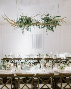 Hanging floral statement pieces are chic and on-trend. Avoid making the table top too busy -- use simple, complementary florals and… Hanging Flower Arrangements, Hanging Centerpiece, Hanging Flowers, Floral Arrangements, Flower Chandelier, Diy Chandelier, Ladder Wedding, Wedding Table, Barn Wedding Decorations