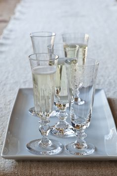 Though it's more traditional to set the table with matching stemware, I think it's also fun to serve mismatched glasses in the same shape. That way, everyone feels like they have a special glass!
