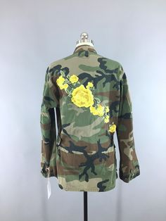 Awesome and completely one-of-a-kind, this vintage US Army jacket has been enhanced with a large yellow floral embroidery patch. The floral embroidery is layered to give it a 3D effect. The jacket its