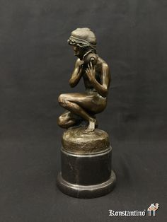 REF-125C Muchacho con caracola. Bronce europeo 1°s S.XX. 40 cms