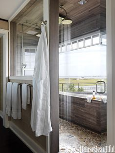 six-by-nine-foot master bathroom shower has stunning bay views. An interior window opens up the whole bathroom to sunlight and the views.