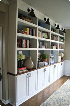 Family Room: DIY built in bookcases butcher block- used upper cabinets for bases. can still have a table in front of it. Would this work for breakfast room? Have larger shelves open and then upper cabinet doors for narrower shelves at top? New Homes, Home And Living, Home Library, Home Living Room, Bookcase, Home, Home Diy, Home Decor, Built In Bookcase