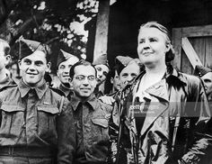 American political journalist Dorothy Thompson Kopf (1894 - 1961) with a group of Czech soldiers, during World War II.