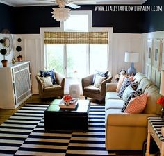 Navy Blue and white striped rug for a nautical vibe: http://www.completely-coastal.com/2015/09/navy-blue-and-white-living-room.html