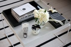 Homevialaura | coffee table books | diptyque | Jo Malone | scented candle | white roses | striped carpet | Balmuir Kensington leather tray | Hay Tray table