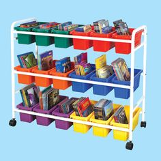 Mix and match tubs to create your own color-coded book cart! Choose angled for easier access to manipulatives and supplies; choose parallel for books! Each tier holds one set of tubs: six wideLifetime Bo Library Organization, Storage Organization, Storage Ideas, Organizing, Best Books Of 2017, Deep Tub, Cool Bookshelves, Bookshelf Speakers, Storage Cart