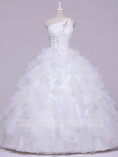 Glamour and fantasy combine in this chic organza #debutantegown. The ruched bodice features an asymmetrical neckline with Swarovski crystal embellishment at the side waist and transforms into frothy layers of ruffled frills trimmed with fluted edging. #lowbackdebdress #debdressesonline  #debdresses  #debdressshop  #debutante #debutantes2016  #debutanteball #debdressesmelbourne #chicdebdress