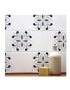 Update the look of your backsplash — without grout — by using tile decals. These adhesive stickers come in various sizes to perfectly cover up dated tile designs, without leaving a sticky residue. We like these Mibo tile tattoos through 2Jane.com, or try Zazzle.com's vintage tile stickers.